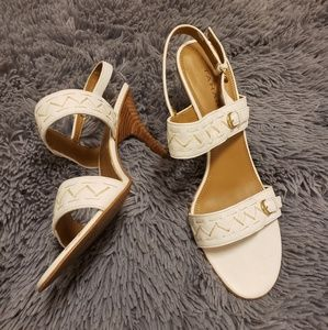 Tahari crest white open toed heeled sandals.